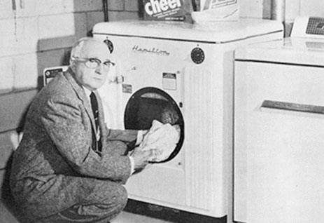 A guy standing in front of first electric powered clothe dryer