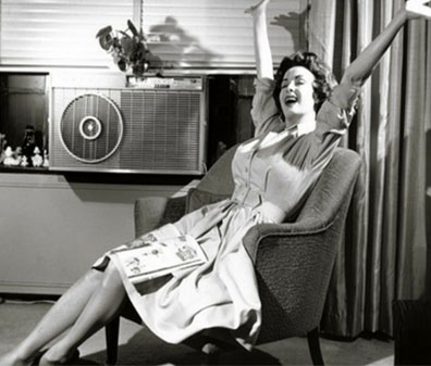 A woman sitting in a room with air contioner