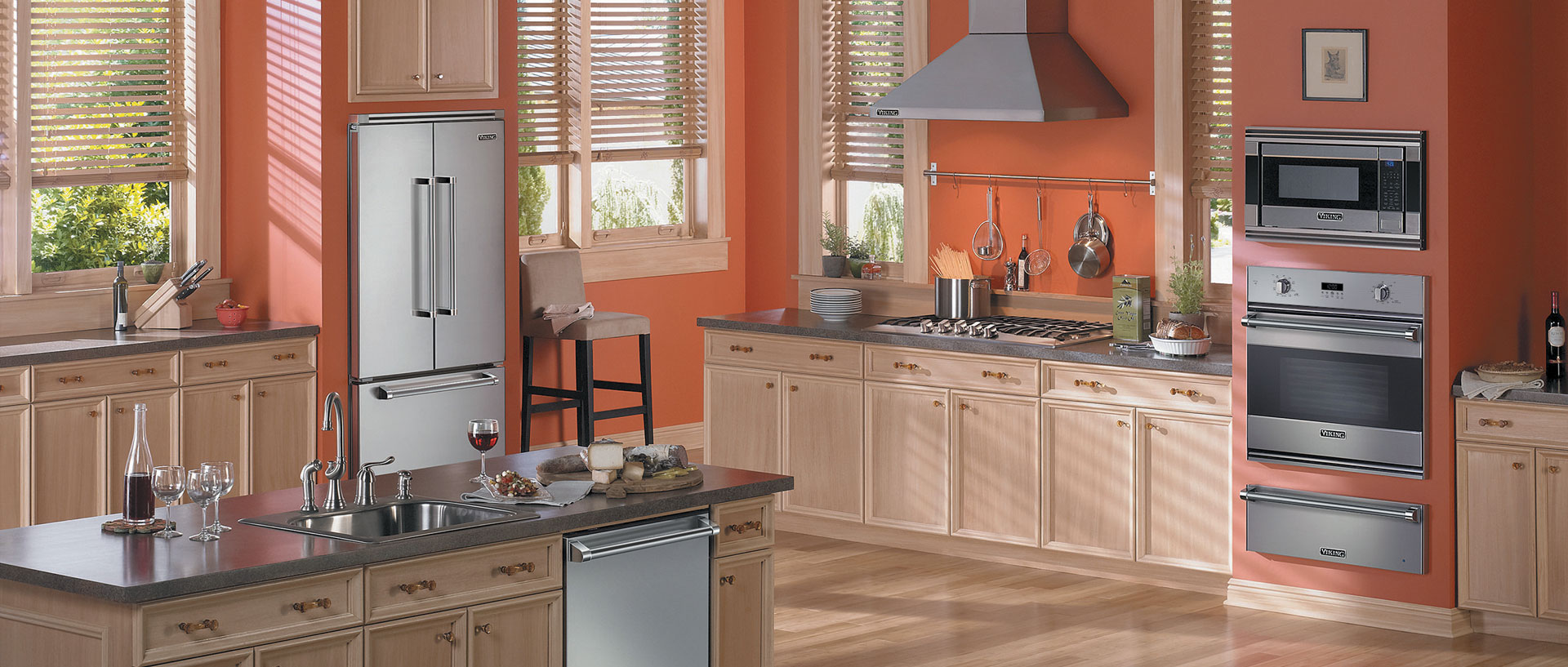 A Viking Kitchen is the heart of any home. Viking Appliances, like the ones in this sunset orange kitchen, can be counted on to deliver unparalleled performance for years.