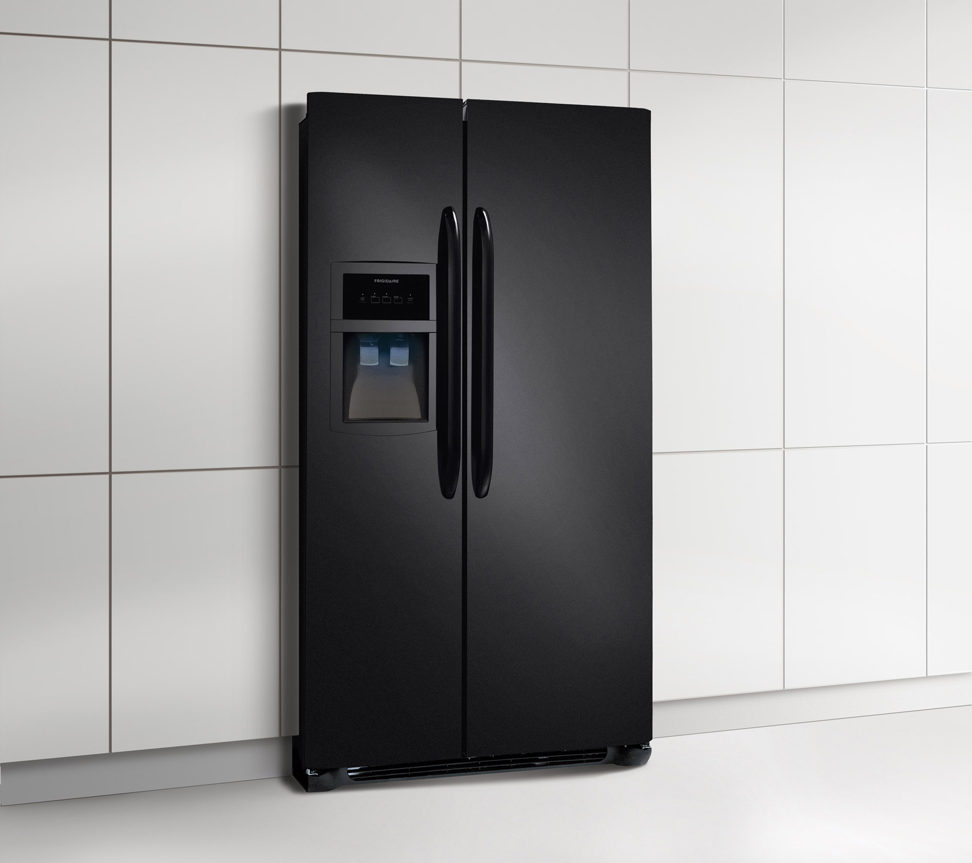 Black Side-by-Side Refrigerator with external water dispenser in front of a white kitchen wall.